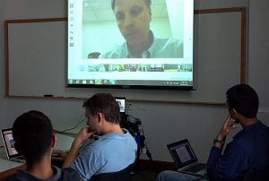 Haas MBAs sit in a global video conference training hosted by Bridges Ventures